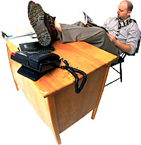 Man with feet on desk